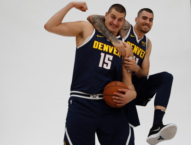 Denver Nuggets center Nikola Jokic, left, ...