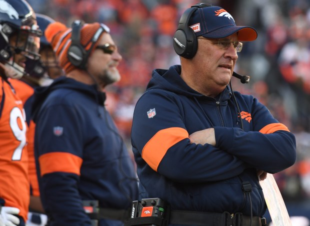 Vic Fangio watches the action on ...