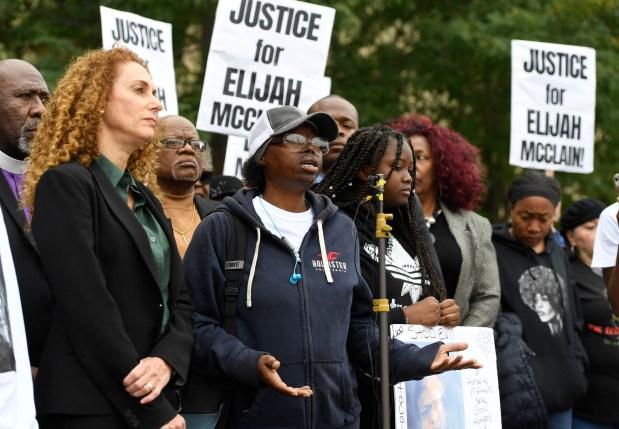 Sheneen McClain, center, mother of Elijah ...