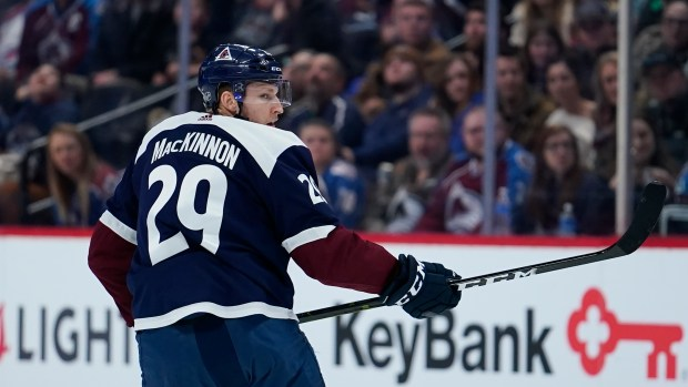 Colorado Avalanche center Nathan MacKinnon skates ...