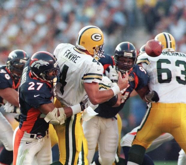 Denver Broncos Steve Atwater knocks the ...