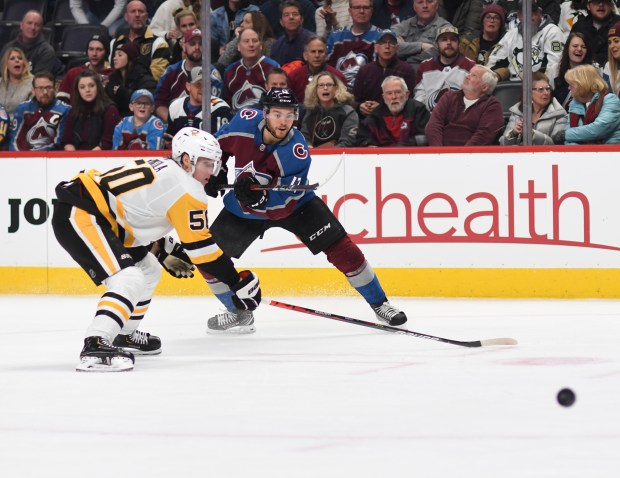 Colorado Avalanche center Tyson Jost (17) ...