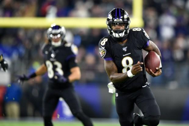 Baltimore Ravens quarterback Lamar Jackson (8) ...