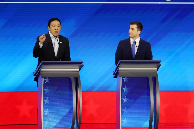 (L-R) Democratic presidential candidates Andrew Yang ...