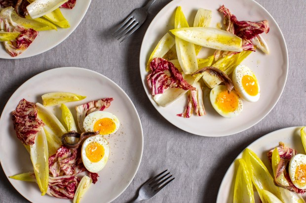An endive salad with egg and ...