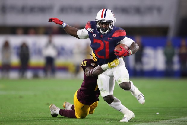 Running back J.J. Taylor #21 of ...