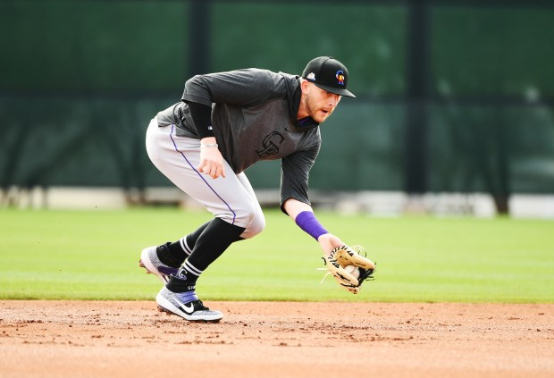 Trevor Story (27) takes ground balls ...