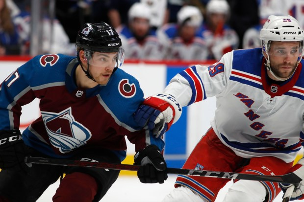 Colorado Avalanche center Tyson Jost, left, ...