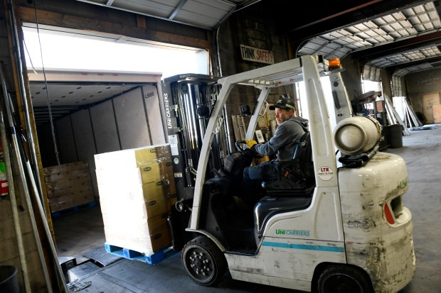 Forklift Operator Don Roland moves a ...