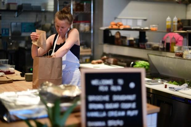 Kelsie Bernes is packing foods for ...