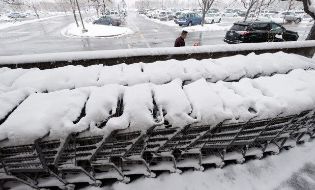 Snow covers carts lined up outside ...