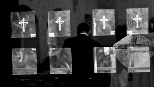Ryan Bradshaw walks to the altar ...