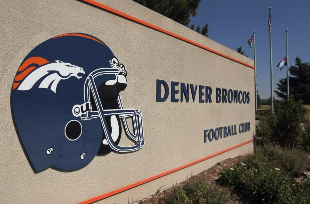 The Denver Broncos team flag flies ...