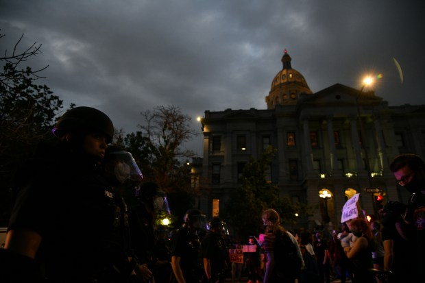Protestors face off with Denver Police ...