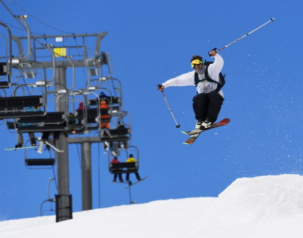 A skier launches off a jump ...