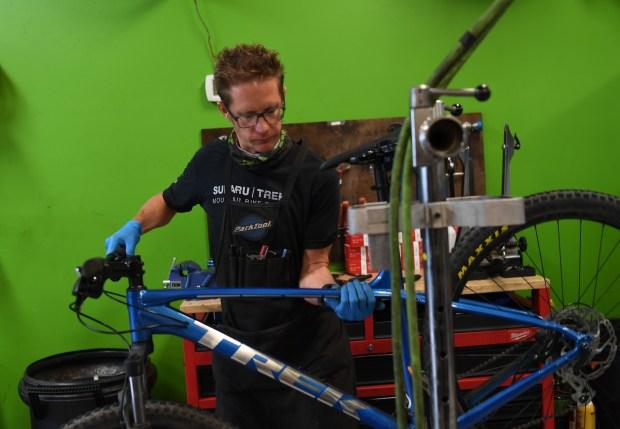 Mike Maxwell works on a bike ...