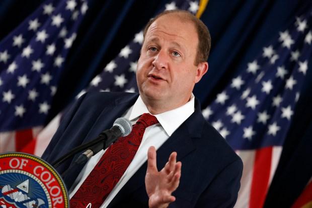 Colorado Governor Jared Polis makes a ...