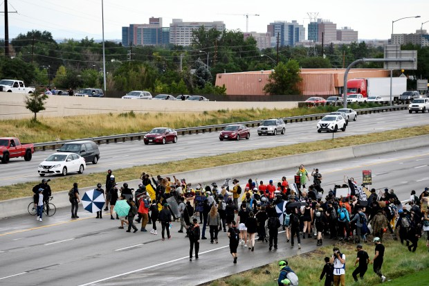 AURORA, CO - July 25: Protesters ...