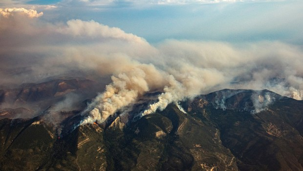 The Pine Gulch wildfire burns north ...