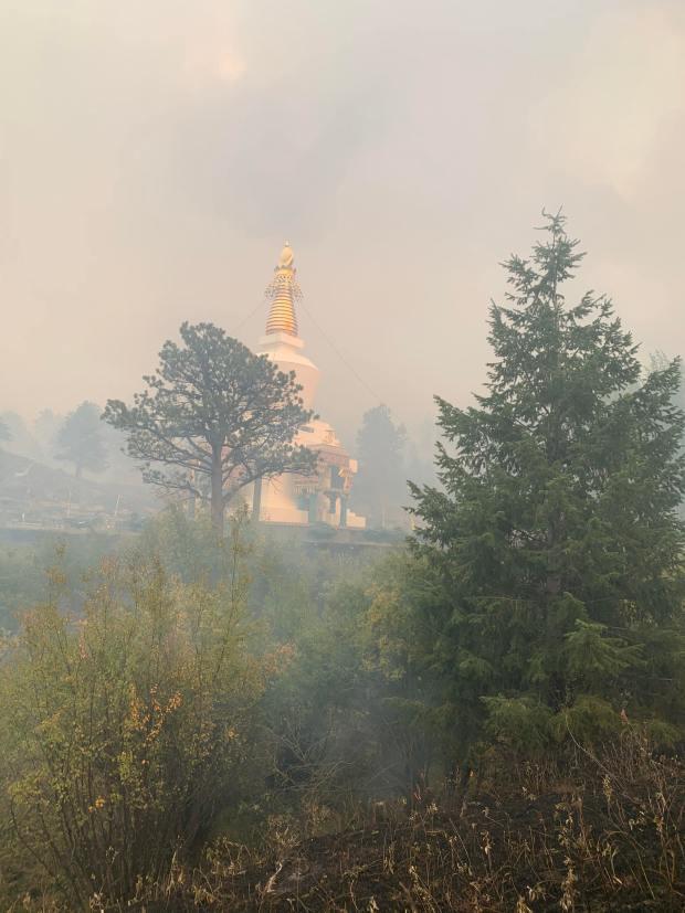fire cameron peak shambhala center mountain stupa sept building buddhist survives retreat landmark reached smoke