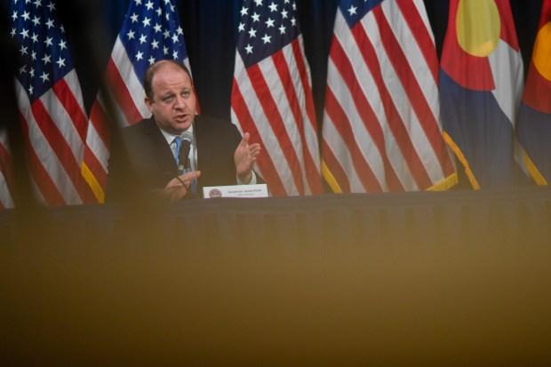 Gov. Jared Polis speaks at the ...