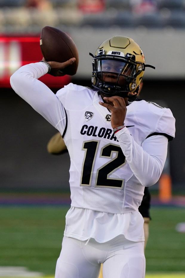 Colorado quarterback Brendon Lewis (12) in ...