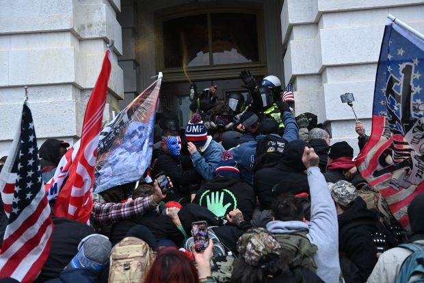 TOPSHOT - Trump supporters clash with ...