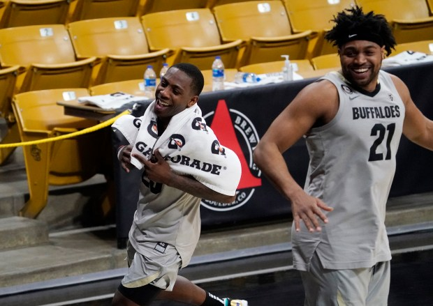 Colorado guard McKinley Wright IV, left, ...