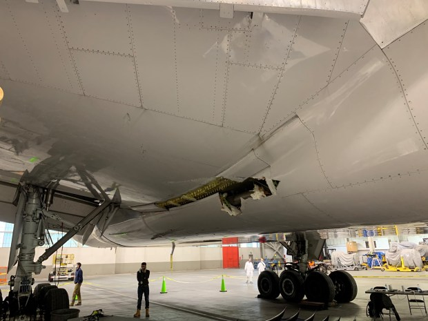 This image taken Feb. 22, 2021, shows the damage to the wing and the body fairing of the United Airlines flight 328 Boeing 777-200, following an engine failure incident Saturday.