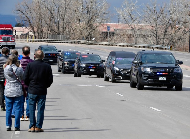 The hearse carrying the body of ...