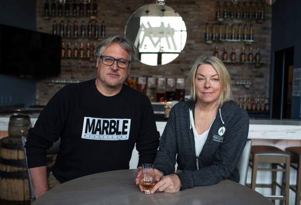 Marble Distilling founders Carey Shanks, left, ...