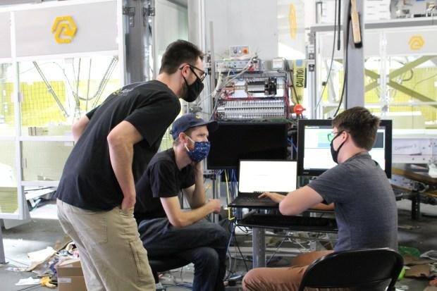 AMP Robotics team members on the job