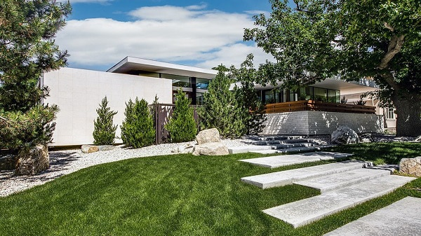 This minimalist modern ranch home, which ...