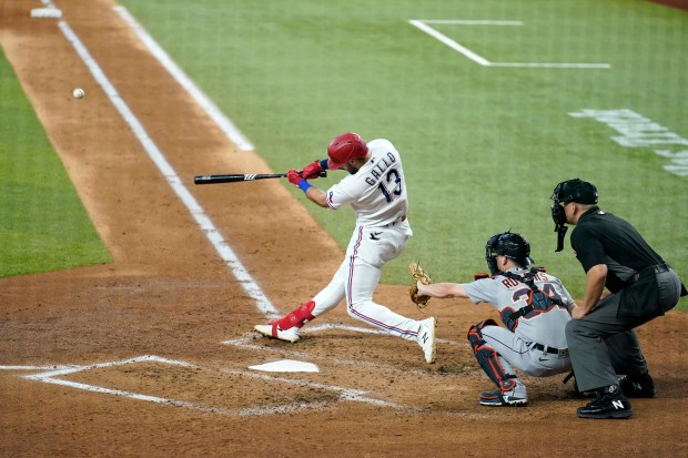 Texas Rangers' Joey Gallo (13) connects ...