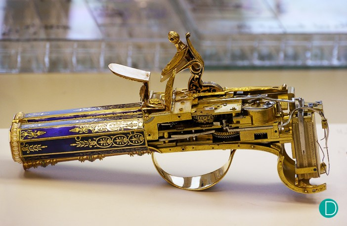The Rochat Singing Bird Pistol, stripped off the covers and being worked at by Raúl.