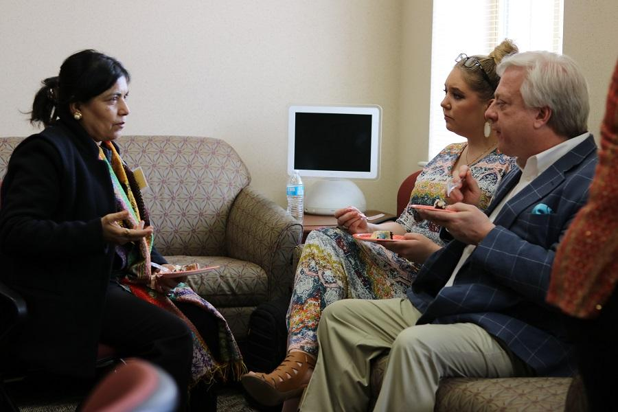 Guests from India and Midland converse in the department lounge.