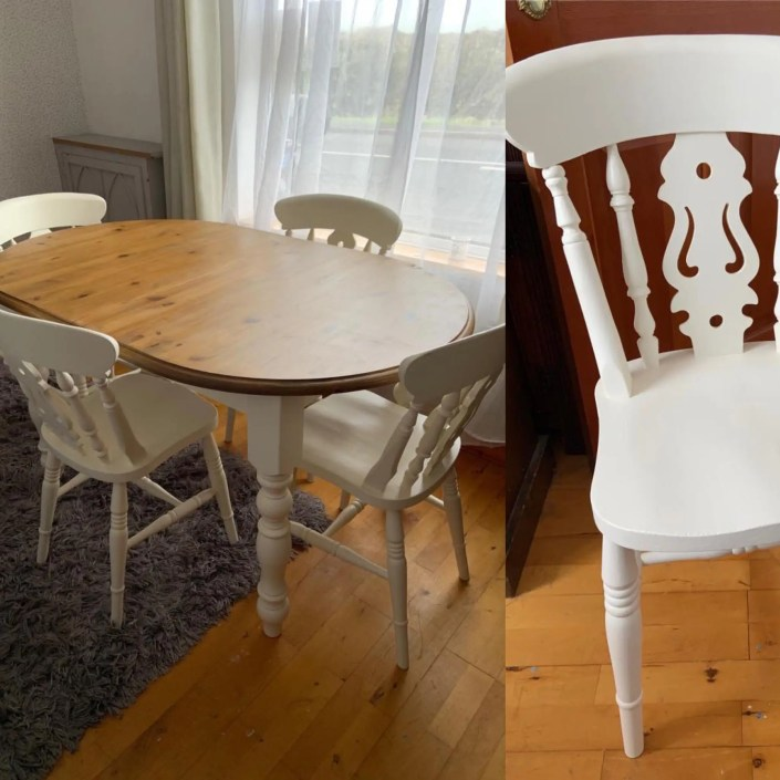 Refurbished rounded wooden table with white painted dining chairs