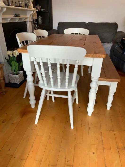 Dining table with painted white legs and stained wood top
