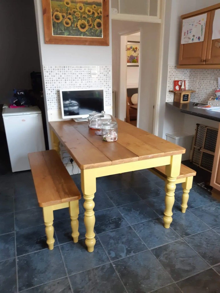 Bespoke dining table for kitchen with yellow legs and reclaimed wood