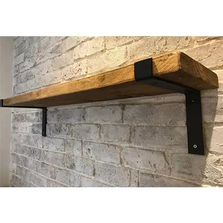 Reclaimed wood shelving with metal fixtures