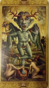 A tarot card with a picture of the devil