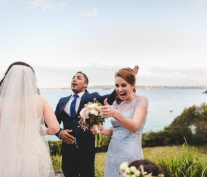 The maid of honour shows her excitement during the ceremony