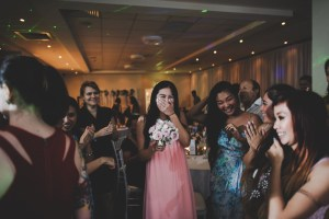Bride Bouquet Toss during St George Motor Boat Club wedding reception