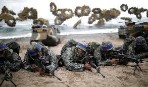 Felles militærøvelser mellom USA og Sør-Korea avlyses som følge av smittefaren.