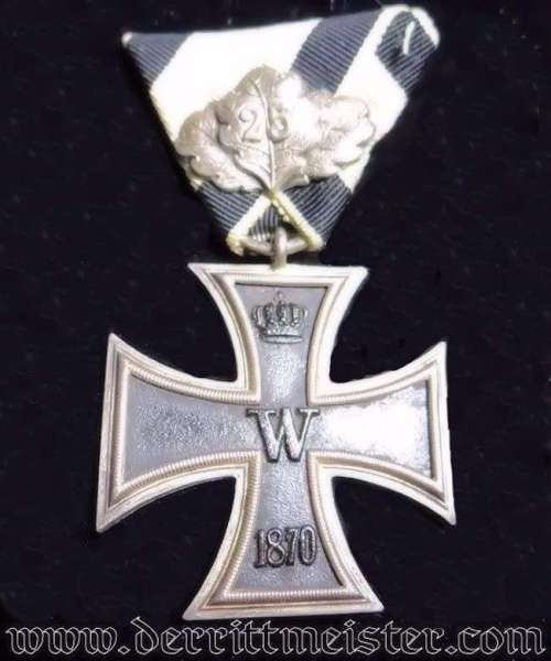 IRON CROSS - 1870 - 2nd CLASS - NON COMBATANTS WITH TWENTY-FIVE-YEAR OAK LEAVES MOUNTED ON TRI-FOLD RIBBON - Imperial German Military Antiques Sale