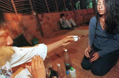 (FILE) Picture taken in February 1999 of a healer (L) starting an Ayahuasca ceremony by offering -what they call- the medicinal plant to a person taking part of the ritual in Tarapoto, northeastern jungle of Peru. The Ayahuasca modifies the state of conciousness and is believed to recover those who take it. AFP PHOTO / JAIME RAZURI (Photo credit should read JAIME RAZURI/AFP/Getty Images)