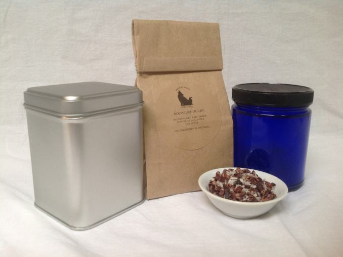 Tea Tin, Minsc Chocolate Bag with ingredients list, blue tea jar, and a small bowl of cacao nibs and coconut flakes