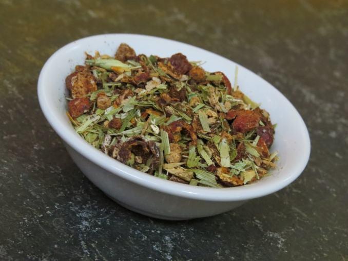 A small white bowl full of 'Molly's Morning Magic' tisane.