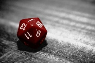 Image of a red 20 sided die, with white numbering.  It has landed on a 1.