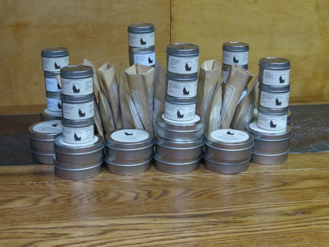 Piles of tea tins as walls and towers around a number of bags of tea.